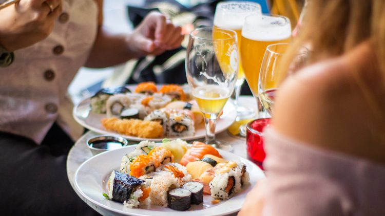A table full of sushi and beer