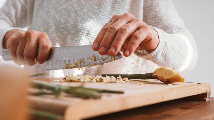Chopping garlic on a cutting board
