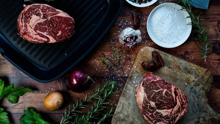 salt and steaks on a table
