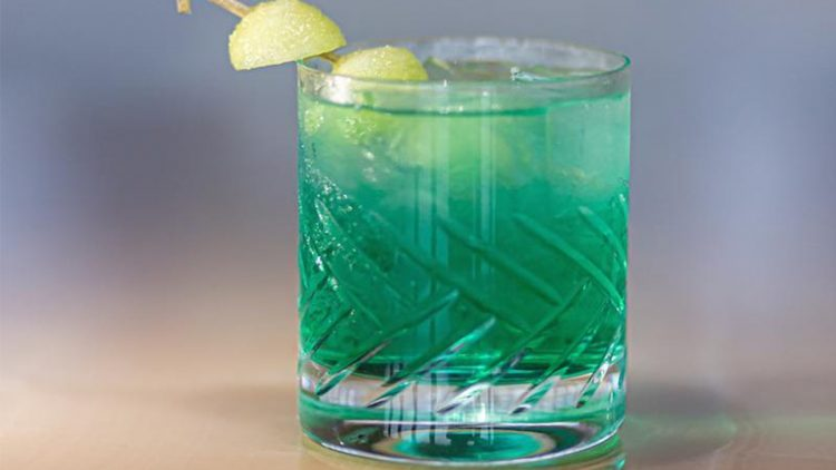 A blue cocktail on the table