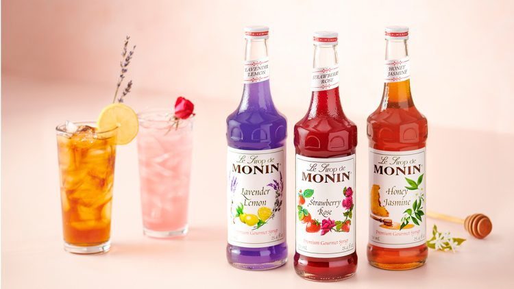 Monin syrups on a table with cocktails