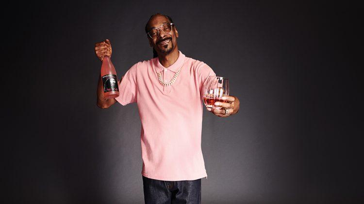 Snoop Dog holding his wine