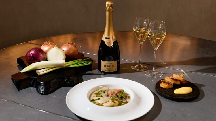 Champagne and food on a table