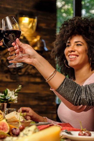 Friends with port wine at a table
